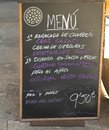 Daily menu at mallorca mediterraneanand mallorcan cuisine in spain with crab salad vegetables soup sea bream chicken with garlic Royalty Free Stock Photos