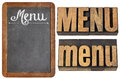 Menu word typography in three versions white chalk text on a slate blackboard and text in vintage letterpress wood type Stock Photography
