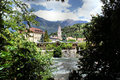 Merano and the passer view on with rapids spa promenade town church of meran in background peaks of texel group Royalty Free Stock Photo