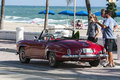 Mercedes benz convertible a classic red at a popular sunny beach in fort lauderdale fl Royalty Free Stock Image