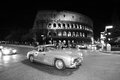 Mercedes benz sl w in rome italy may gullwing built transits front of the colosseo during the miglia historic car race on may Stock Photo