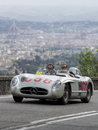 Mercedes benz srl driven by david coulthard formula one racing driver driving the along via bolognese florence italy during the Stock Photos