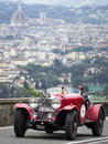 Mercedes benz ss driven by jochen mass formula one recing driver driving the along via bolognese florence italy during the miles Stock Images