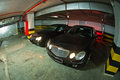 Mercedes E-Class w211 and CLK-Class w209 on underground parking Royalty Free Stock Photo