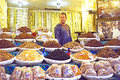 Merchant is selling dried fruit fes marocco october fruits and nuts in the medina from fes on october Royalty Free Stock Photos