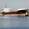 Merchant ship berthed at the harbour in a sunny day Royalty Free Stock Photos