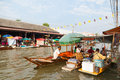 The merchants sell the foods at Umpawa Floating Market Royalty Free Stock Photo