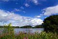The mere at ellesmere looking over on a sunny day Royalty Free Stock Photo