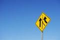 Merge sign traffic against blue sky Stock Photo