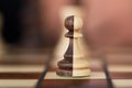 Merged chess pawns closeup of on chessboard Royalty Free Stock Images