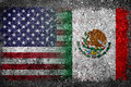 Merged Flags of USA and Mexico Painted on Concrete Wall Royalty Free Stock Photo