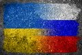 Merged russian and ukrainian flags painted on concrete wall of russia ukraine a political concept of both countries past union Stock Photos