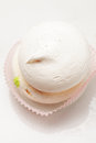 Meringue cake above view small in a pink paper plate Royalty Free Stock Image
