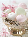 Meringue cookies in bowl with flower selective focus Stock Images