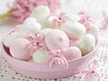 Meringue cookies in bowl with flower selective focus Stock Photos