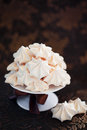 Meringue cookies on cake stand selective focus Royalty Free Stock Photography