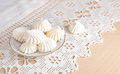 Meringue on a lacy cloth white Stock Images