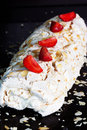 Meringue roulade with cream,strawberries and raspberries Royalty Free Stock Photo
