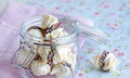 Meringue swirls with chocolate in a glass jar Royalty Free Stock Image
