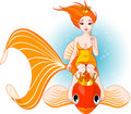Mermaid riding on a golden fish Royalty Free Stock Photos