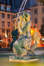 Mermaid statue in the baroque fountain of rossio square at night lisboa portugal Royalty Free Stock Image