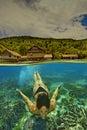 Mermaid in Tropical Seas, Raja Ampat, Indonesia Royalty Free Stock Photo