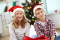 Merriment portrait of happy siblings looking at camera on christmas evening Royalty Free Stock Photography