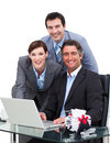 Merry business team working at a computer Royalty Free Stock Photo