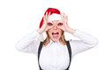 Merry businesswoman in santa hat Royalty Free Stock Photography