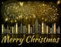 Merry Christmas background decorated with fireworks exploding in night sky over downtown city Royalty Free Stock Photo