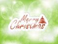 Merry christmas background glowing green with a tree and space for text Royalty Free Stock Photos