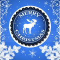 Merry christmas blue background with fir branches snowflakes and a moose in the middle greeting concept Royalty Free Stock Photo