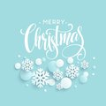 Merry Christmas blue background with papercraft snowflake. Greeting lettering card. Vector illustration Royalty Free Stock Photo