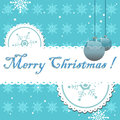 Merry christmas blue greeting with balls snowflakes and the text written in blue Stock Photography