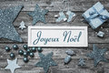 Merry Christmas card in blue and white with french text on woode Royalty Free Stock Photo