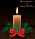 Merry christmas card with candle and happy new year realistic branch and red bow on wood table Stock Photography