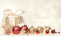 Merry christmas card with gift and ornaments gold red or poster tied a ribbon shiny glass decorative stars Stock Photography