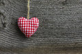 Merry christmas decoration gingham fabric heart handmade hearth over rustic elm wood background retro style design copy space Stock Photos