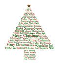 Merry christmas in different languages forming a tree Royalty Free Stock Image