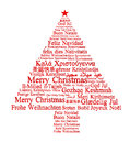 Merry christmas in different languages forming a tree Royalty Free Stock Photo