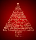 Merry christmas in different languages forming a tree Royalty Free Stock Photos