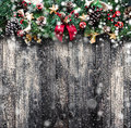 Merry Christmas Frame with Snow and real wood green pine and baubles Royalty Free Stock Photo