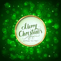 Merry Christmas on green sparkle background Royalty Free Stock Photo