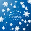 Merry Christmas greetings card. Origami snowfall. White paper cut snow flake. Happy New Year. Space for text Royalty Free Stock Photo