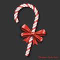 Merry Christmas Greetings in Realistic 3D Red Candy Cane on Black Background. Vector Celebrations Illustration Royalty Free Stock Photo