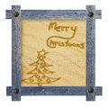 Merry Christmas handwritten on sandy background. Wooden blue fra Royalty Free Stock Photo