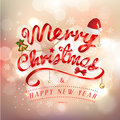 Merry Christmas and Happy New Year greeting card festive inscription with ornamental elements on bokeh vintage background Royalty Free Stock Photo
