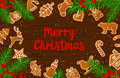 Merry Christmas and Happy New Year seasonal winter card background gingerbread cookies on wooden texture table
