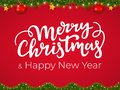 Merry Christmas and Happy New Year typographical postcard on red Xmas background with festive holiday garland Royalty Free Stock Photo