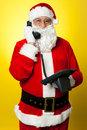 Merry christmas how are you santa wishing via call Stock Photography